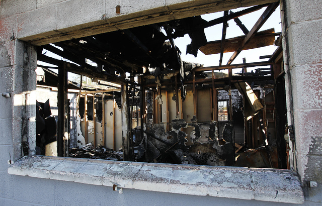 The charred remains are all that is left of the fire ravaged home at 2116 Carver Ave. in North Las Vegas on Nov. 30, 2013. Several vacant, arson-plagued homes across several of the city's most b ...