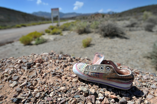 A child's shoe is seen near the perimeter of the well-guarded military installation on Tuesday, Aug. 5, 2014. The super secret site, known as Area 51, is full of conspiracy theories about extra-te ...