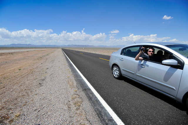 A  motorist records his travels along state route 375 or the Extraterrestrial Highway, as he enters the desert town of Rachel, Nev. on Tuesday, Aug. 5, 2014. Rachel is the nearest town to the supe ...