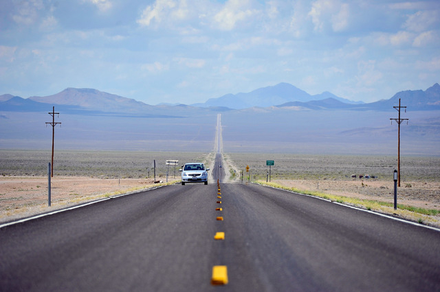Motorists travel along state route 375 or the Extraterrestrial Highway, near the desert town of Rachel, Nev. on Tuesday, Aug. 5, 2014. Rachel is the nearest town to the super secret military base, ...