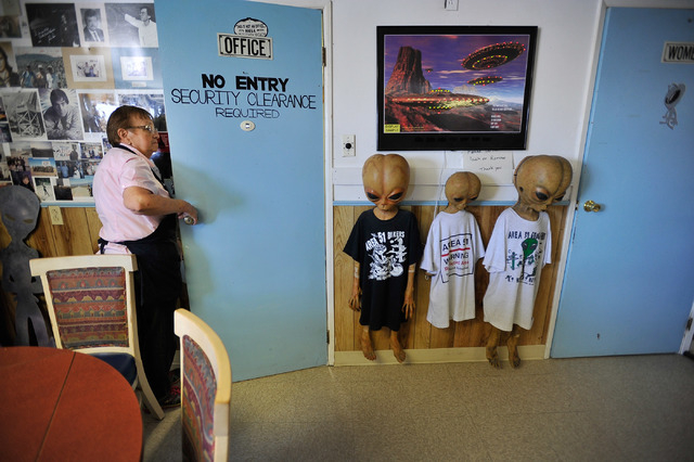 Pat Travis, owner of the Little A'Le'Inn in Rachel, Nev., opens her office door on Tuesday, Aug. 5, 2014. Travis has owned the bar, restaurant and motel for over 20 years and which is a favorite s ...