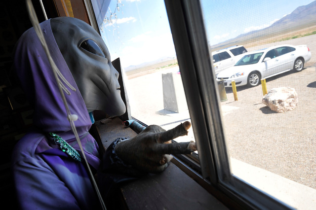 A plastic alien like creature greets visitors from a window at the Little A'Le'Inn in Rachel, Nev. on Tuesday, Aug. 5, 2014. The bar, restaurant and motel is a favorite stop for visitors of Area 5 ...