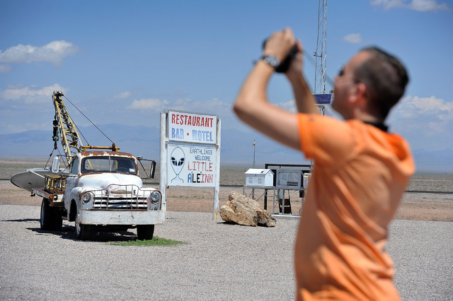 Floris Otten, of The Netherlands, photographs some of the artifacts found at the Little A'Le'Inn in Rachel, Nev. on Tuesday, Aug. 5, 2014. The bar, restaurant and motel is a favorite stop for visi ...