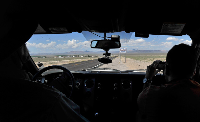"""Dean Baumgartner, left, certified tour guide for Adventure Photo Tours drives up to the """"Welcome to Rachel, Nevada""""  road sign along state route 375 or the Extraterrestrial Highway allow ..."""