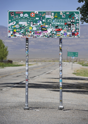 The Extraterrestrial Highway sign, covered with stickers, is seen along star route 375 on Tuesday, Aug. 5, 2014.   State officials drew inspiration from the alien legends at Area 51and dubbed the  ...