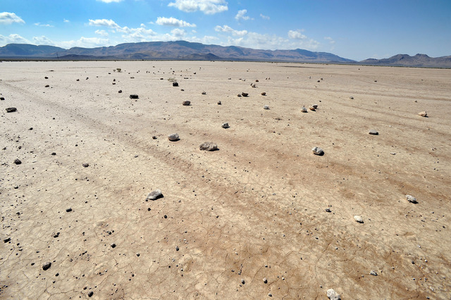 Rocks scattered over the Delamar Dry Lake are seen on Tuesday, Aug. 5, 2014. Over the years the lake bed has been designated as an emergency landing strip for various test flights and as landing s ...