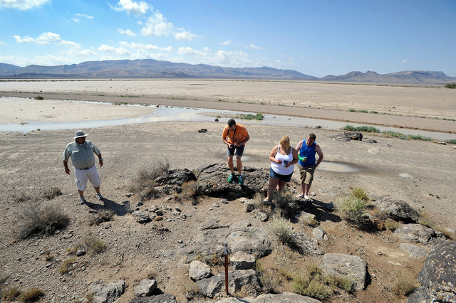 Dean Baumgartner, left, of Adventure Photo Tours, leads tourists Floris Otten, second left, of The Netherlands and  Becky Cooper and Shane Cooper of England, on a tour of Delamar Dry Lake on Tuesd ...