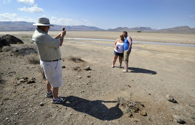 Dean Baumgartner, left, of Adventure Photo Tours, photographs Becky Cooper and Shane Cooper of England, on a tour of Delamar Dry Lake on Tuesday, Aug. 5, 2014.  Baumgartner lead a a small group of ...