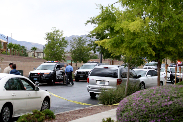 Las Vegas Metropolitan Police investigate an officer-involved shooting at Calico Fields Street and Balcony Trellis Avenue in northwest Las Vegas, Monday, August 11, 2014. (Michael Quine/Las Vegas  ...