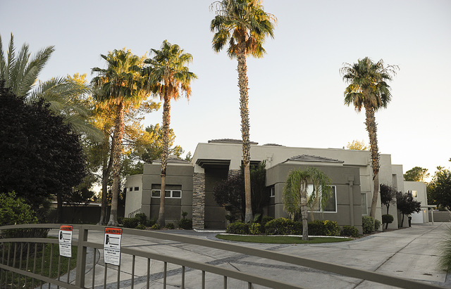"Nigel Burton's ""party house"" at 616 Campbell Drive in Las Vegas is seen on Thursday, Aug.14, 2014. The activity at this house sparked the latest effort to crack down on people who buy ho ..."