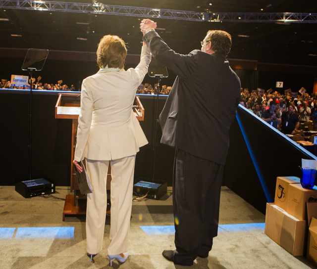Leo W. Gerard,right,  International President of the United Steelworkers raises  House Minority Leader Nancy Pelosi, D-Calif., arm after she addressed the annual United Steelworkers convention at  ...