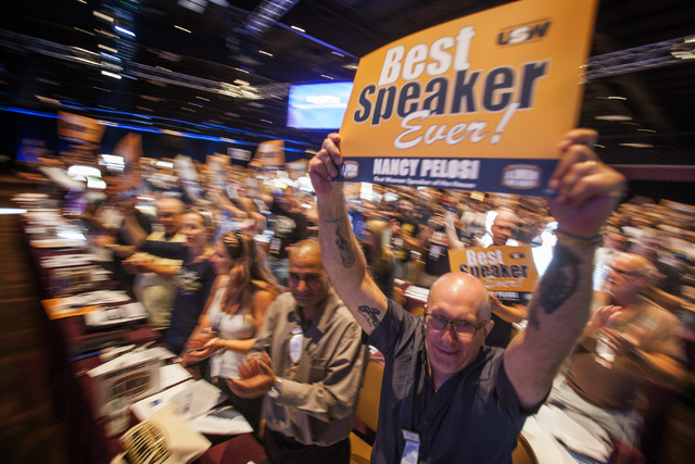 People cheer House Minority Leader Nancy Pelosi, D-Calif., before addressing the annual United Steelworkers convention at the MGM Grand Convention Center on Monday, Aug. 11, 2014. Around 2,500 del ...