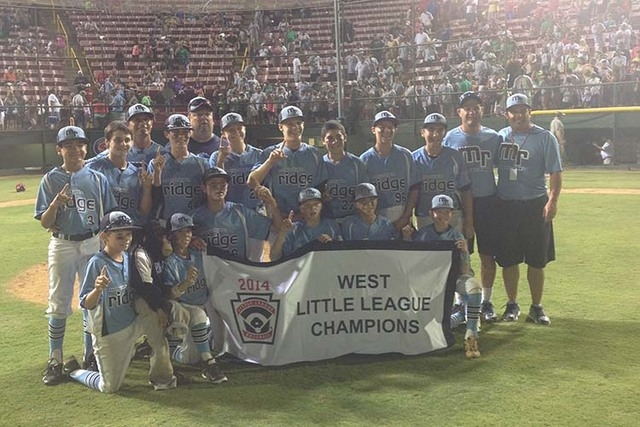 The Mountain Ridge Little League team poses after winning the West regional 11-2 over Northern California. (Ed Graney/Las Vegas Review-Journal)
