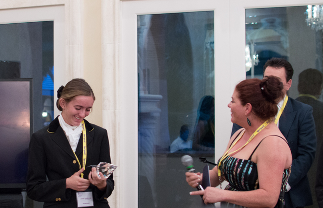 Lauren Sokolowski, left, receives an award from Amy Meyer, right, at a White Horse Youth Ranch gala event July 19 in Las Vegas. (Fernando Lopez/Special to View)
