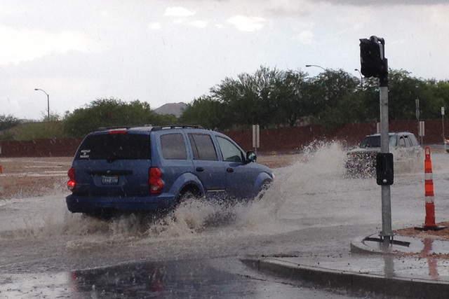 Flooding is seen at the intersection of Blue Diamond and Durango on Monday, August 4, 2014. (Jason Bean/Las Vegas Review-Journal)