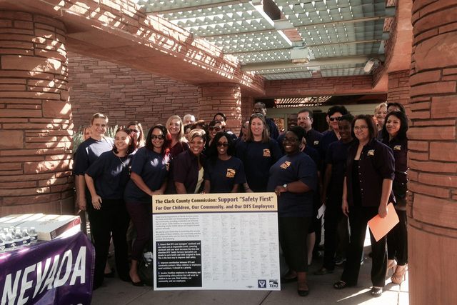 Members of the Service Employees International Union take photos on Tuesday, August 5, 2014, before presenting a petition to make improvements in the child welfare agency. (Yesenia Amaro/Las Vegas ...