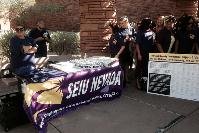 Members of the Service Employees International Union gather before the Clark County Commissioners meeting on Tuesday, August 5, 2014. (Yesenia Amaro/Las Vegas Review-Journal)