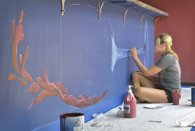 Artist Natalie Tremayne works on a mural which is part of the decor at Pinot's Palette in The District at Green Valley Ranch at 2260 Village Walk Drive in Henderson on Thursday, Aug. 14, 2014. The ...
