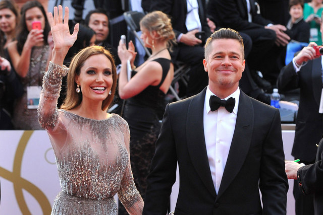 Angelina Jolie and Brad Pitt arrive at the Oscars in Los Angeles on March 2, 2014. Jolie and Pitt were married Saturday, Aug. 23, 2014, in France, according to a spokesman for the couple. (Vince B ...