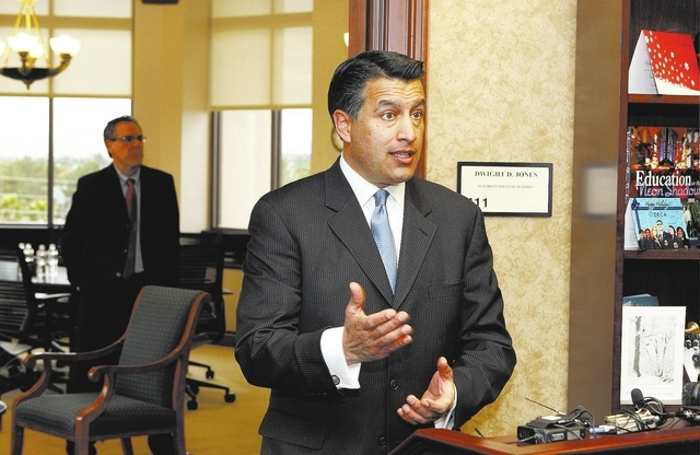 JOHN GURZINSKI/LAS VEGAS REVIEW-JOURNAL Governor elect Brian Sandoval answers questions during a press conference before meeting with the new  CCSD Superintendent Dwight Jones and Walt Rulffes at  ...