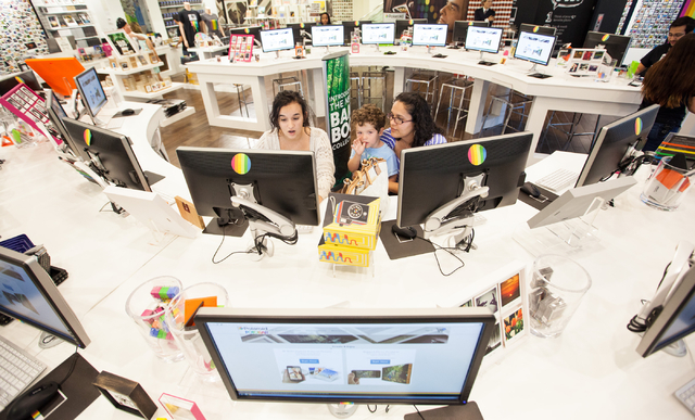 Isabel Saenz, from left, Santiago Saenz, 3, and Gaby Saenz, all of Las Vegas, customize photos on a computer at Polaroid Fotobar at The Linq in Las Vegas on Wednesday, June 25, 2014. (Chase Steven ...
