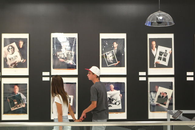 Fifteen-year-olds Mazeli Jimenez and Elliot Trask, both of Las Vegas, walk through the Polaroid Museum at Polaroid Fotobar at The Linq in Las Vegas on Wednesday, June 25, 2014. (Chase Stevens/Las  ...