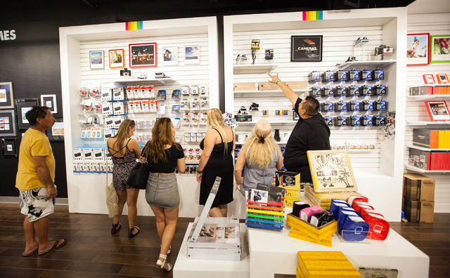 People look through items at Polaroid Fotobar at The Linq in Las Vegas on Wednesday, June 25, 2014. (Chase Stevens/Las Vegas Review-Journal)