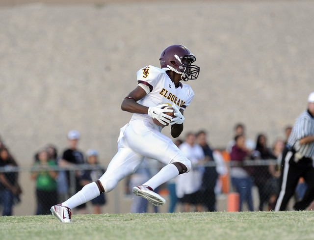 Eldorado Sun Devils kick returner Joshua Brown returns the opening kickoff for a touchdown against the Chaparral Cowboys during high school football game at Chaparral High School in Las Vegas Frid ...