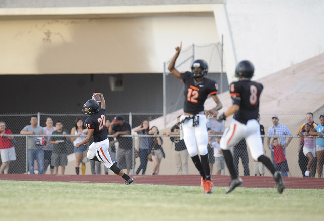 Chaparral Cowboys kick returner Richard Nelson returns a kickoff for a touchdown against the Eldorado Sun Devils in the first quarter high school football game at Chaparral High School in Las Vega ...