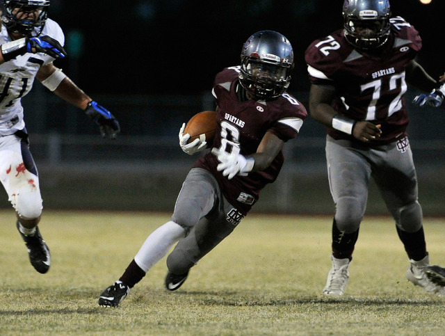 Cimarron-Memorial's Maurice Bennett (8) breaks free from the pack as he runs with the ball during a high school football game against Cheyenne at Cimarron-Memorial High School on Friday, Aug. 29,  ...
