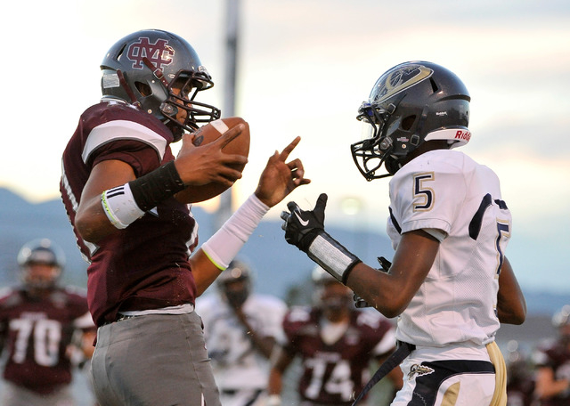 Cimarron-Memorial's Joe Tito, left, reacts after making a reception against Cheyenne's Darryl Jones during a high school football game at Cimarron-Memorial High School on Friday, Aug. 29, 2014. (P ...