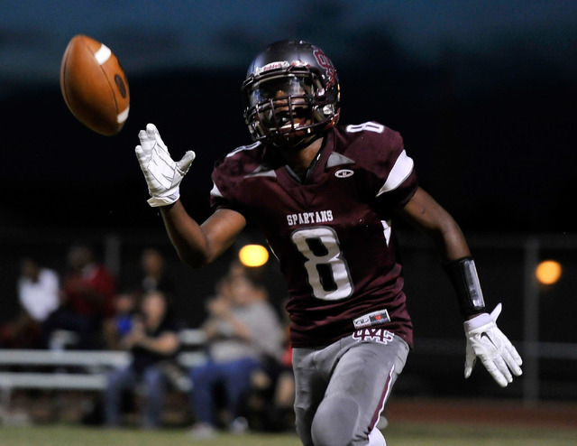 Cimarron-Memorial's Maurice Bennett tosses the ball after scoring on a two-point conversion during a high school football game against Cheyenne at Cimarron-Memorial High School on Friday, Aug. 29, ...