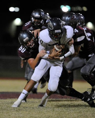 Cheyenne quarterback AJ McConnico is sacked during a high school football game against Cimarron-Memorial at Cimarron-Memorial High School on Friday, Aug. 29, 2014. (Photo by David Becker/Las Vegas ...