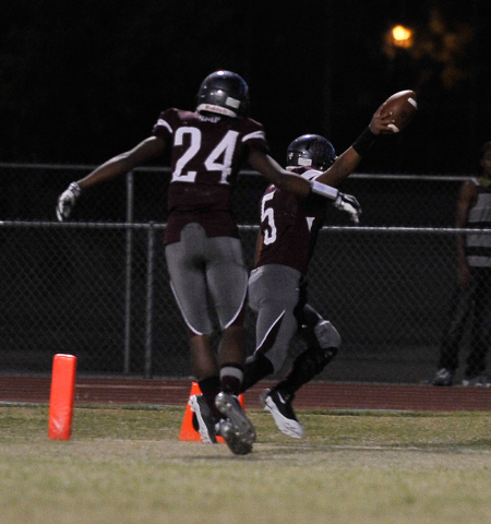 Cimarron-Memorial quarterback Derek Morefield (5) and Rasaan Mills (24) react after running the ball in for a touchdown against Cheyenne during a high school football game at Cimarron-Memorial Hig ...