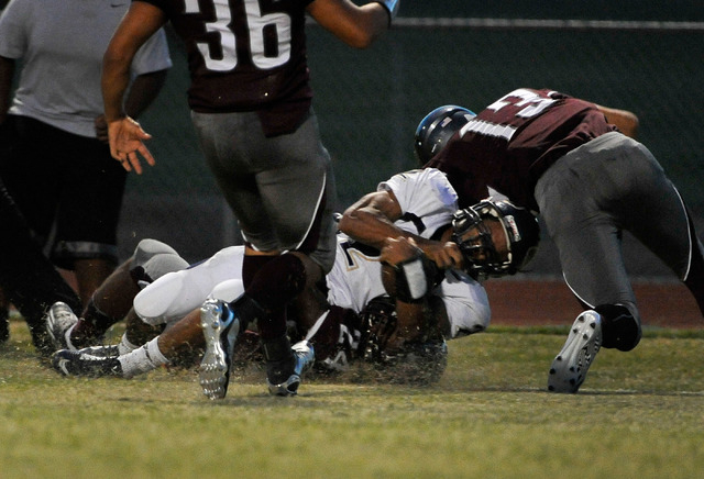 Cheyenne's Zavieh Harrell (2) is tackled by Cimarron-Memorial after running the ball into the end zone  for a touchdown during a high school football game at Cimarron-Memorial High School on Frida ...