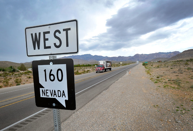 Motorists travel along Nevada Highway 160 in Red Rock Canyon National Recreation Area on Tuesday, Aug. 12, 2014. The Bureau of Land Management is in the midst of an environmental study for a propo ...