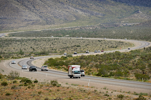 Motorists travel along Nevada Highway 160 in Red Rock Canyon National Recreation Area on Tuesday, Aug. 12, 2014. The  Bureau of Land Management is in the midst of an environmental study for a prop ...