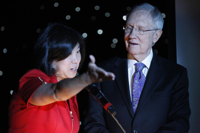U.S. Rep. Grace Meng, D-Queens, left, and U.S. Sen. Harry Reid, D-Nev., take the stage during the Asian Chamber of Commerce's monthly lunch at the Gold Coast casino-hotel in Las Vegas Thursday, Au ...