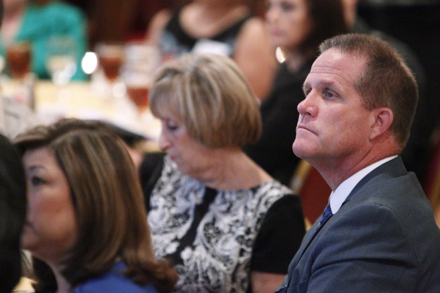 State Sen. Mark Hutchison, R-Las Vegas, listens to U.S. Sen. Harry Reid, D-Nev., during the Asian Chamber of Commerce's monthly lunch at the Gold Coast casino-hotel in Las Vegas Thursday, Aug. 21, ...