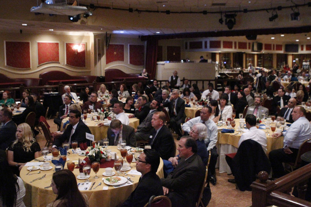 People listen to U.S. Sen. Harry Reid, D-Nev., during the Asian Chamber of Commerce's monthly lunch at the Gold Coast casino-hotel in Las Vegas Thursday, Aug. 21, 2014. (Erik Verduzco/Las vegas Re ...