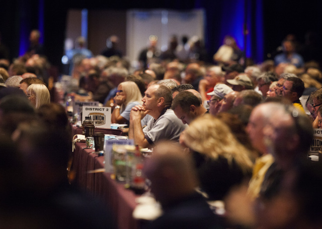 People listen while U.S. Sen. Harry Reid, D-Nev. speaks during the annual United Steelworkers convention at the MGM Grand Convention Center on Wednesday, Aug. 13, 2014. Around 2,500 delegates are  ...