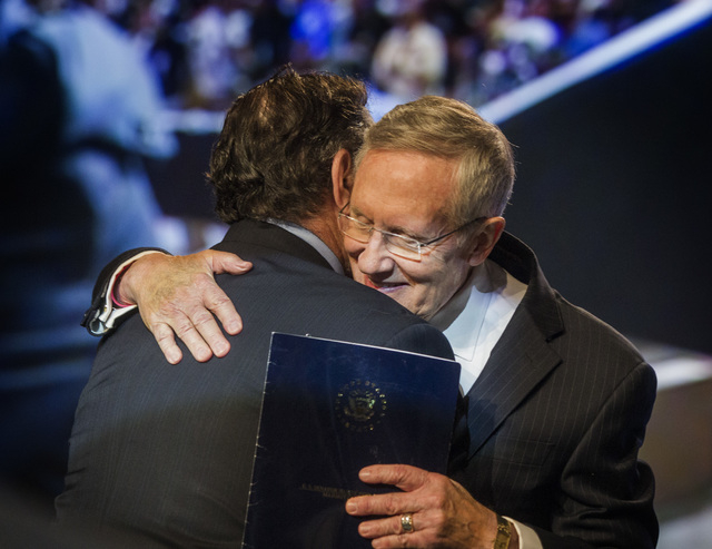 U.S. Sen. Harry Reid, D-Nev. ,right, embraces  Leo W. Gerard,  International President of the United Steelworkers, before speaking at the annual United Steelworkers convention at the MGM Grand Con ...