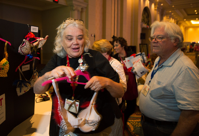 "Sandra Sutain, shows a decorated bra to her husband, Vanlawrence Sutain (cq), during a session announcing ""The Uplift Project"" during the Hadassah National Convention at The Venetian on Wednesday, ..."