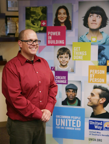 Jacob Murdock, community engagement manger for the United Way of Southern Nevada, stands in the lobby of United Way of Southern Nevada Monday, Aug. 11, 2014, in Las Vegas. Millennials, who are you ...