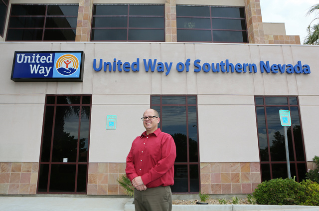 Jacob Murdock, community engagement manger for the United Way of Southern Nevada, stands outside of United Way of Southern Nevada Monday, Aug. 11, 2014, in Las Vegas. Millennials, who are young ad ...