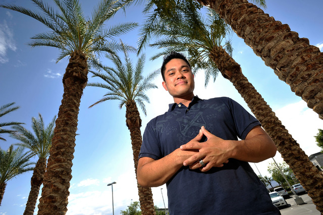 Brian Naldoza poses outside his Las Vegas office building on Monday, Aug. 11, 2014. Naldoza hosts a local Atheists Meetup Group and he believes he doesn't need religion to be a good person. (David ...