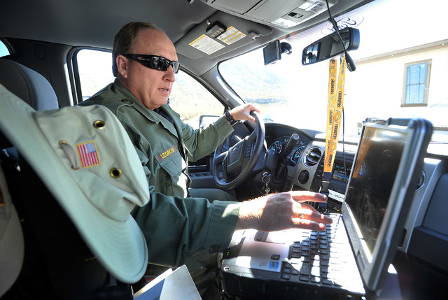 Las Vegas police Sgt. Andy LeGrow checks his computer as he prepares to patrol upper Kyle Canyon Road on Mount Charleston on Tuesday, Aug. 26, 2014. LeGrow leads a team of six officers that patrol ...