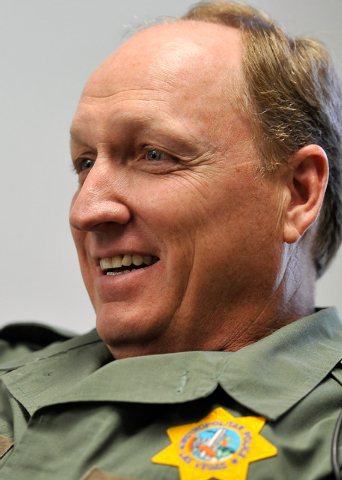 Las Vegas police Sgt. Andy LeGrow smiles during an interview at his Mount Charleston office on Tuesday, Aug. 26, 2014. LeGrow leads a team of six officers that patrols the unincorporated area nort ...