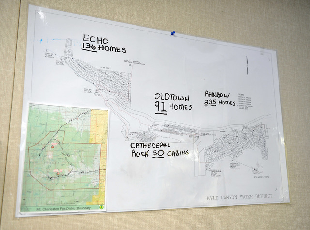 A residential map of upper Kyle Canyon hangs on the wall at the Las Vegas police's Mount Charleston sub station on Tuesday, Aug. 26, 2014. A team of six officers and a sergeant are assigned to pat ...