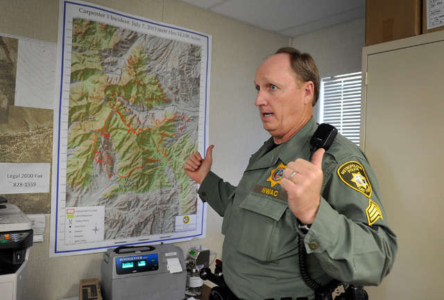 Las Vegas police Sgt. Andy LeGrow refers to a map showing the Carpenter 1 fire during an interview at his Mount Charleston office on Tuesday, Aug. 26, 2014. LeGrow leads a team of six officers tha ...
